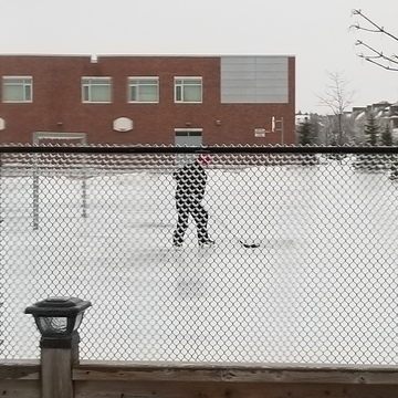 Playing hockey on schoolyard soccer field