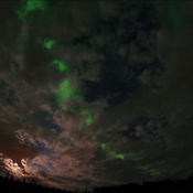 Clouds, moon , and northern lights