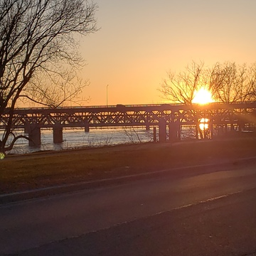 Nice red sun set in MTL , over the Mercier Bridge