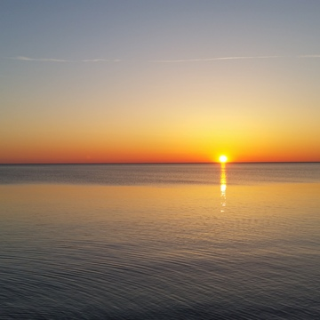 sun rise over isthmus bay