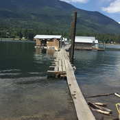 Procter Boathouses floating in high Kootenay river water level.