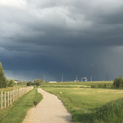 storm clouds on pathway behind Carburn Park #Riverbend #calgary #yyc #abstorm
