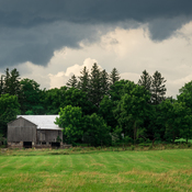 Barn Under Clouds