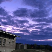 Purple sky over football field
