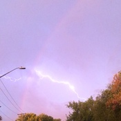 Early morning rainbow during lighting storm
