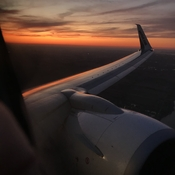 Sunset on plane wing