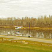 Reflections of a float plane on the Snye.