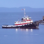another tug going to its berth