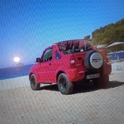 Red Jeep on a sandy beach on a beautiful sunny day ☀️☀️