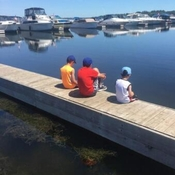 The ( 3 ) brothers are chatting by the lake while dad is fishing nearby 🌞🌞