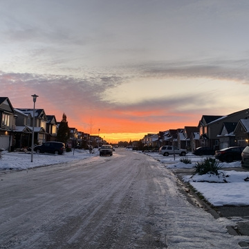 Sunset over unplowed icy street in London On.