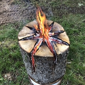 burning a log torch to keep warm on cool day