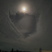 Moon in cloud hole
