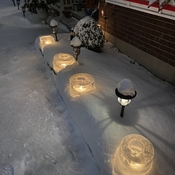 Ice candles on a snowy night