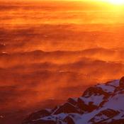 Orange Ocean - vapour steaming off a chilly sea in January. ( Sun rise )