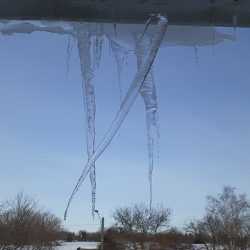icicles are forming on the eaves at odd agles.