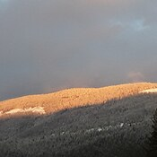 Sunset over Owl Head mountain in Sicamous, fresh snow