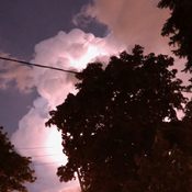 Lightening behind clouds