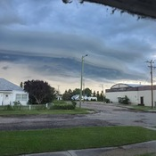 Shelf cloud hanging over small town