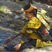 A Kalash girl washes clothes in a stream, Pakistan (2011)