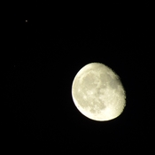 The moon tonight ,, with a star or planet to the far top left corner ...