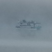 Houseboat in the fog.