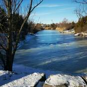 Frozen Rough River in winter in sunny day