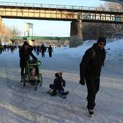 Walking as a family on the Assiniboine River.