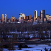 1 of 2, A glowing office towers before sunrise Calgary, Alberta