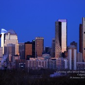 2 of 2, A glowing office towers before sunrise Calgary, Alberta