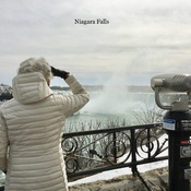 No people at Niagara Falls. 2 Canadians wearing masks. #backyardweather