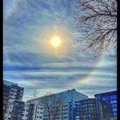 """Sundoggie "" setting sun in the downtown of Edmonton"